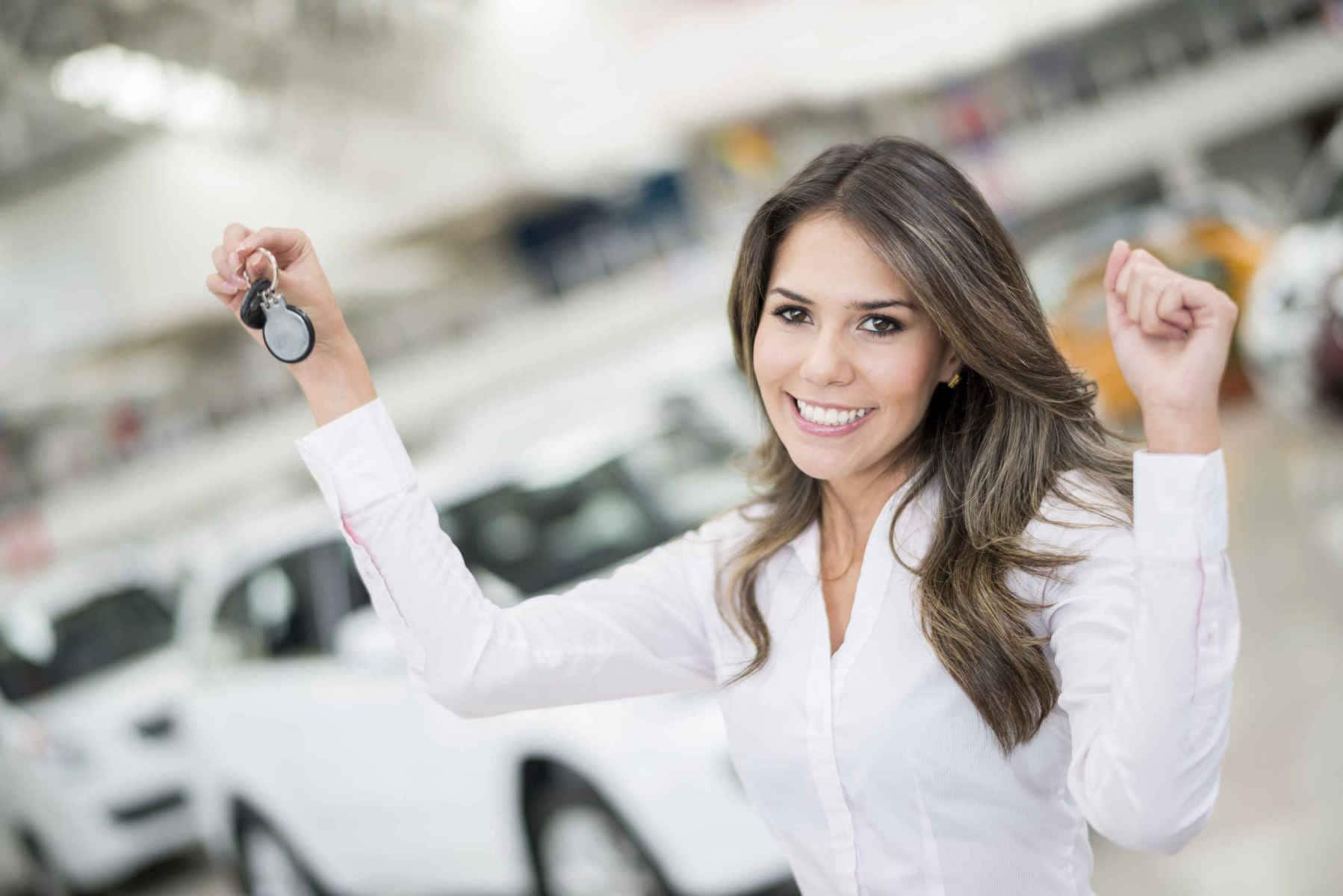 happy woman buying a car and holding keys